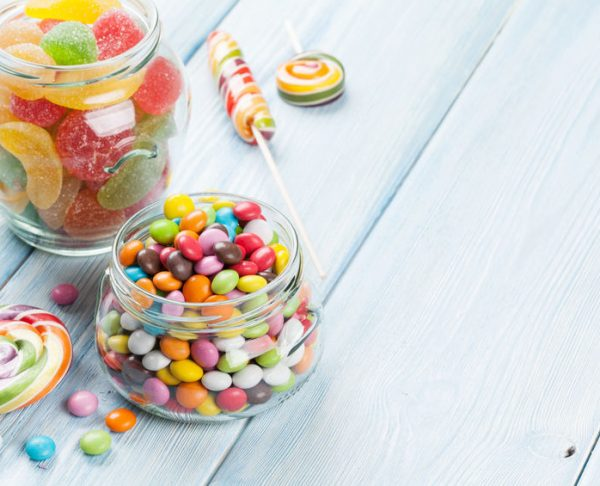 Colorful candies on wooden table